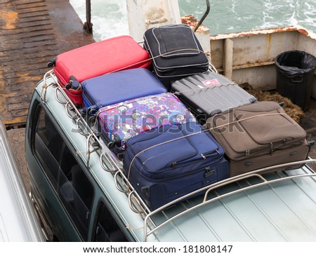 Suitcases on the car - stock photo