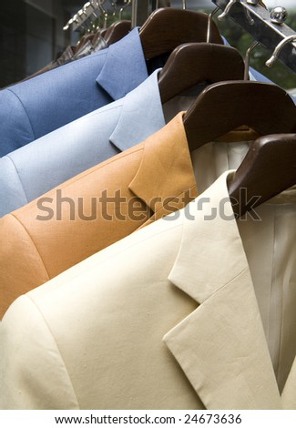 Suits hang on the stand - stock photo