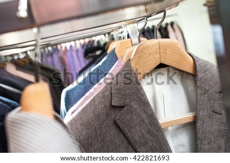 suits on hangers in store - stock photo