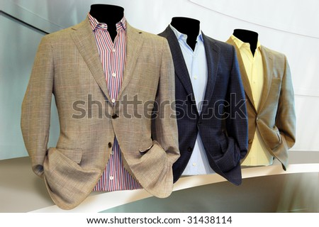 Suits on shelf - stock photo