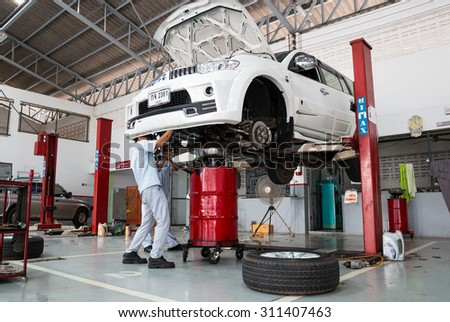 SUKHOTHAI - AUGUST 22:mechanic repairing a car at MItsubishi Motor Service station on August 22, 2015 in Sukhothai, Thailand. - stock photo