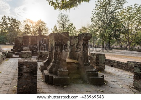 Sukhothai historical park, Wat Si Chum temple, ruins of a small chapel with Buddha statue - stock photo