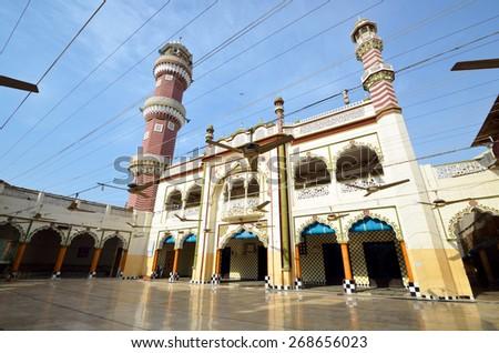 SUKKUR, PAKISTAN ? MARCH 28 2015: Ali Masjid has two tall minarets and is a landmark of Sukkur. - stock photo