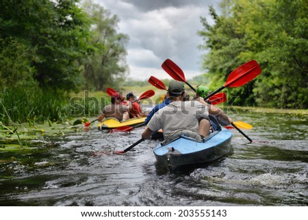 Sula, Ukraine - June 14, 2014: river rafting kayaking editorial photo; river, Sula, 2014 Ukraine, June 14 - stock photo