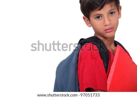 Sulky looking schoolboy - stock photo