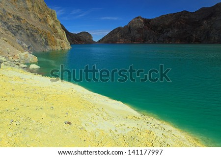 Sulphates lake in a crater of volcano Ijen. Java. Indonesia - stock photo
