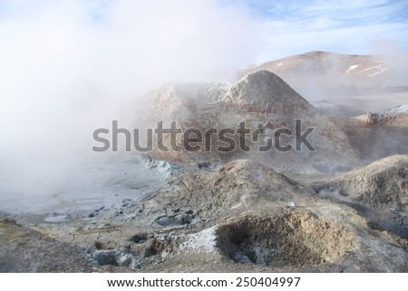 Sulphuric acid pools of geyser in Altiplano of Bolivia - stock photo