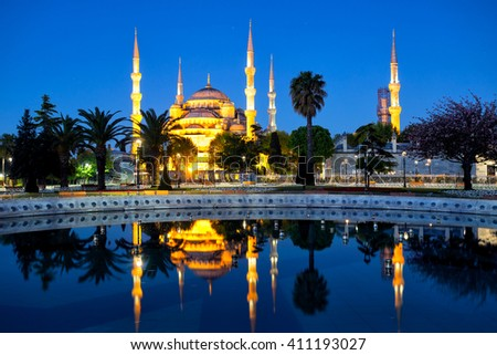 Sultanahmet Mosque (Blue Mosque) with reflection shot at night. Istanbul, Turkey. - stock photo