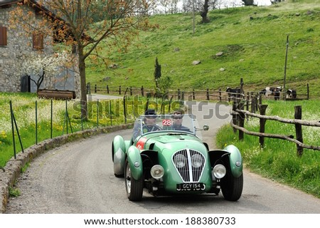SULZANO, ITALY - APRIL 12: A green Healey Silverstone takes part to the Franciacorta Historic classic car race on April 12, 2014 in Sulzano. This car was built in 1949. - stock photo