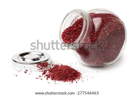 Sumac spice in glass jar on white background - stock photo