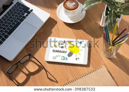 SUMMARY CONCECT on tablet on screen, table and coffee Business - stock photo