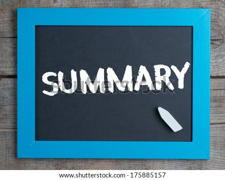 Summary. Creative composition with the message summary on blackboard on wooden table - stock photo