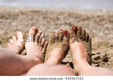 Summer and beach concept - couple lying on the beach. Couple feet on sand relaxing on the beach. - stock photo