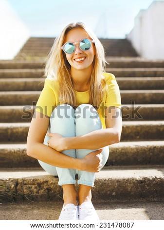 Summer and fashion concept - portrait pretty fun blonde girl in sunglasses outdoors - stock photo