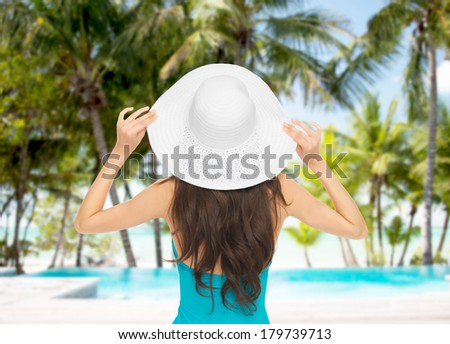 summer and holiday concept - model in swimsuit with hat - stock photo