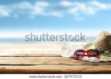 summer background of desk and hat and glasses  - stock photo
