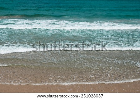 Summer background: sea shore, turquoise waves, splashes, breaking wave, surf - stock photo