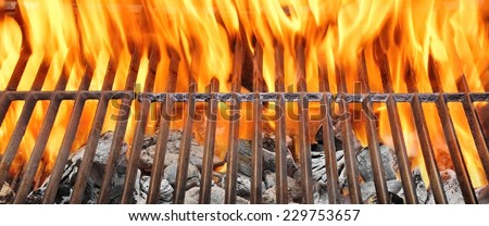 Summer BBQ in the Backyard. Clean Barbecue Grill with Fire and Flame. Food Barbeque Background. - stock photo