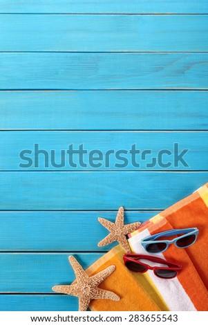 Summer beach background vertical, blue wood deck, copy space - stock photo