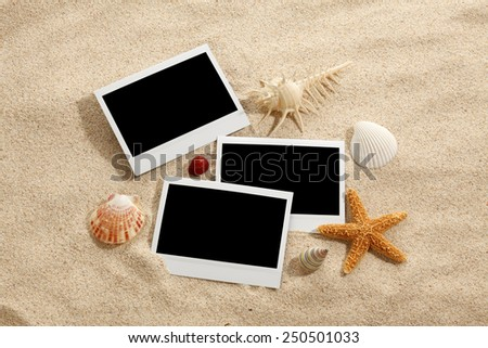 Summer beach concept/Sandy beach with blank pictures - stock photo