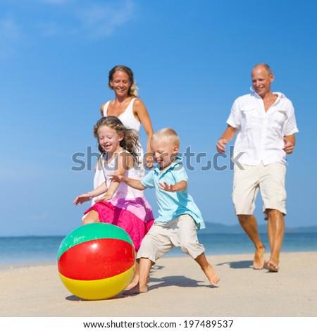 Summer Beach Family Fun. - stock photo