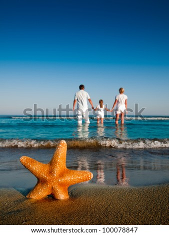 Summer beach - family on summer holiday - stock photo