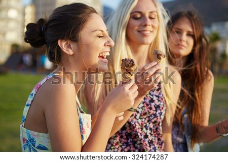 Summer beach ice cream fun laughing teenagers - stock photo