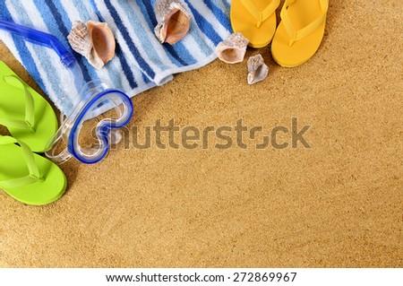 Summer beach sunbathing background, towel, flip flops.  Copy space. - stock photo