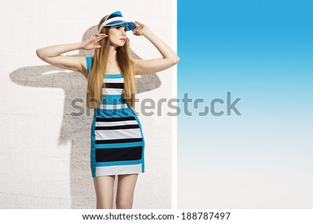 Summer beauty in blue visor - stock photo