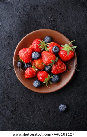 summer berries on plate, food top view - stock photo