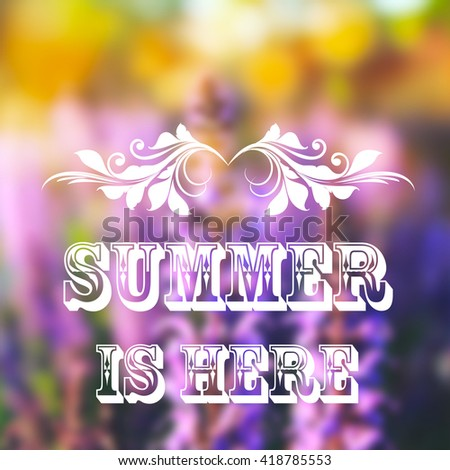 "Summer blurred background with blossom flowers and text ""Summer is here"" - stock photo"