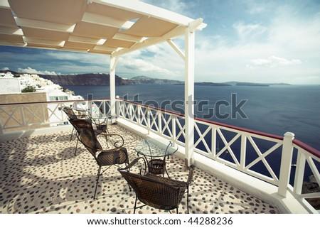 summer cafe at Oia, Santorini island, Greece - stock photo