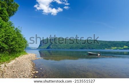 Summer calm on Norwegian fjord - stock photo