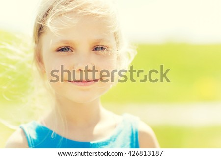 summer, childhood, leisure and people concept - happy little girl outdoors - stock photo
