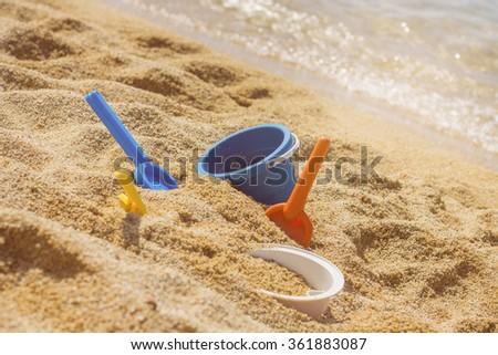 Summer Children's Beach Toys on the sand. - stock photo