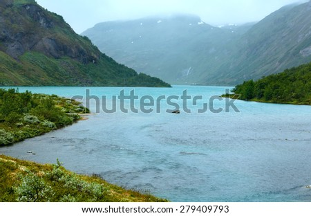 Summer cloudy mountain and fjord landscape (Norway). - stock photo
