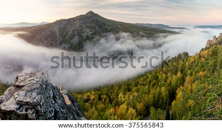 Summer cloudy sunrise mountain panorama view (Russia, Ural Mountains). Ten shots stitch image. - stock photo