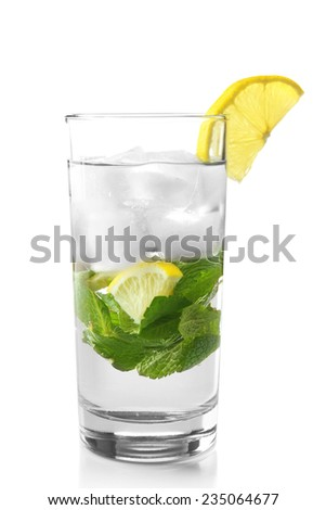 Summer cocktail with ice cubes isolated on white - stock photo
