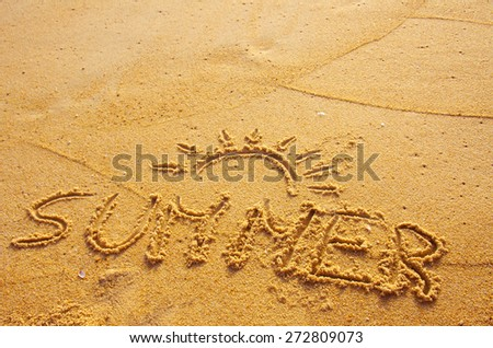 Summer concept of beach with word summer written on the sand - stock photo