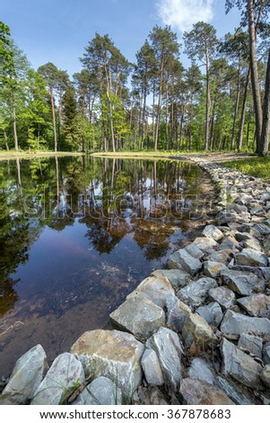 Summer day on small  lake in the forest,  Eastern Poland - stock photo