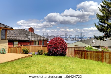 Summer day view from the back yard of Seattle and Space Needle. - stock photo