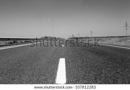 summer deserted road. monochrome photos - stock photo