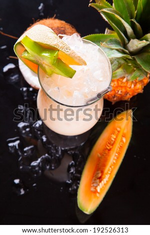 Summer drink on black stone, table. - stock photo