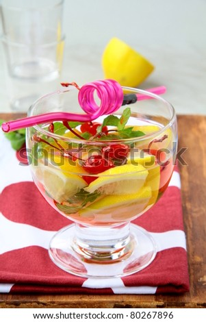 summer drink sangria with fruit in a large glass - stock photo