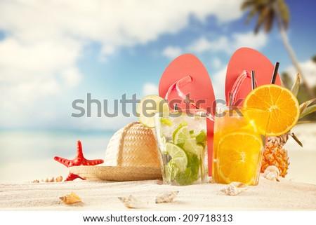 Summer drinks on beach with sea shells - stock photo
