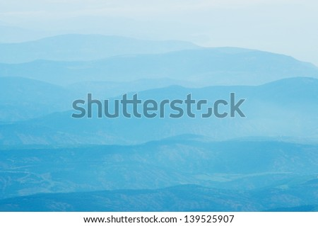 Summer early morning foggy Himalayas mountains landscape - stock photo