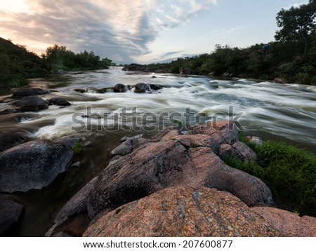 Summer evening at the river - stock photo