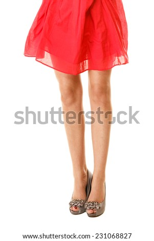 Summer fashion and elegance. Sexy female legs in high heels isolated on white. Part of woman body. - stock photo