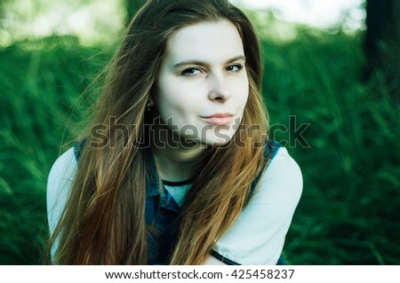 Summer fashion portrait of glamour sensual young stylish lady wearing trendy summer outfit, black hat, denim junce and denim vest. Beautifull model with long  hair outdoors. - stock photo
