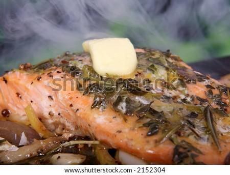 Summer food, rose colored fish steak in a wine marinade macro closeup - stock photo